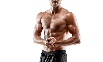 Portrait young sexy handsome man of strong athlete's body with bare torso. Posing on white studio background