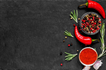 Red hot chili peppeprs and peppercorns with rosemary and garlic