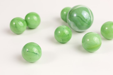 group of glass marbles in green