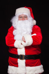 Christmas. Santa Claus portrait smiling against black background.