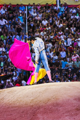 Foto op Canvas Stierenvechten bullfighter making movements in front of the spectators in the arena