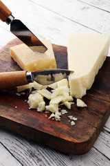 An aged authentic parmigiano reggiano parmesan cheese with cheese knife