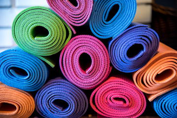 Pile of colorful yoga mats