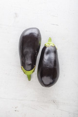 Top of view  fresh eggplant on white concrete background