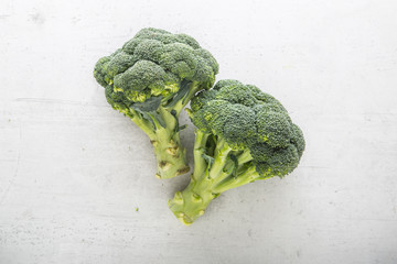 Top of view  fresh broccoli on white concrete background