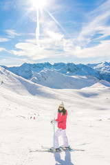 Young woman skier enjoying a sunny day in the snow