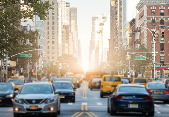 Traffic along 3rd Avenue in New York City with Sunlight Background