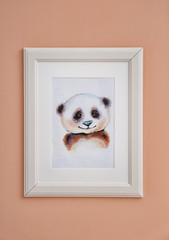 Picture of panda on wall in baby room