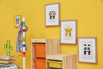 Baby room with pictures of animals on wall