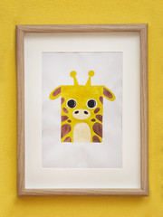 Picture of giraffe on wall in baby room