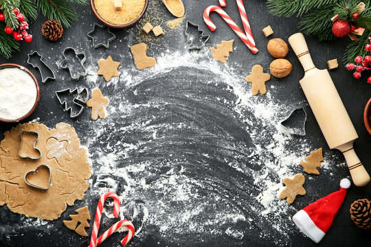 Baking christmas cookies on grey wooden table