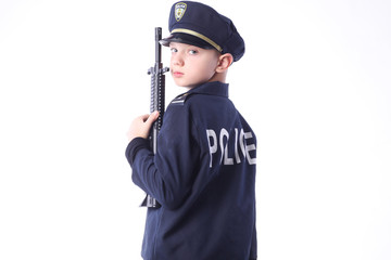 Young boy in policeman costume.