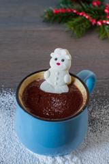 Marshmallow snowman shape taking a warm hot chocolate bath