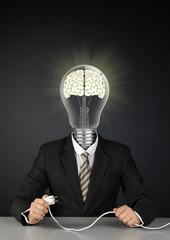 Businessman with light bulb head and plug, switch brain creative concept