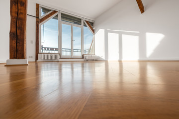 empty room with wooden floor and terrace window -