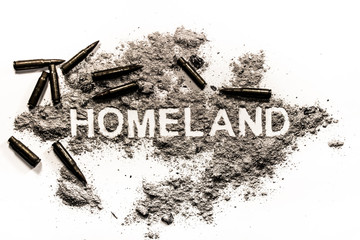 Homeland word written in ash and bullets