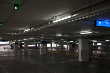 Empty parking garage in the shopping center. There is also a fire in the sign to give the user access to the parking.