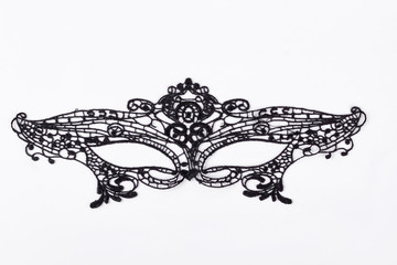 Black lace mask for masquerade. Black delicate lace mask isolated on a white background. Black carnival mask.