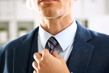 Male arm in blue suit set tie closeup