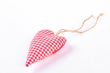 Handmade textile checkered heart. Red handmade cloth heart isolated on white background. Symbol of love and romance forever.