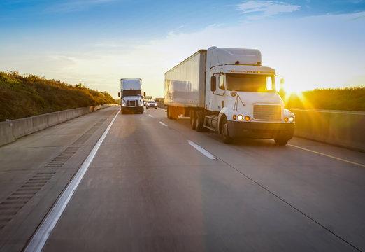Semi truck on highway at sunset