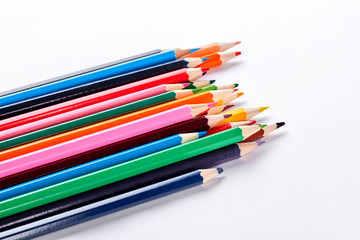 Pensils of different colors on white background. Variety of colorful pencils on white background. Equipment for drawing at school.