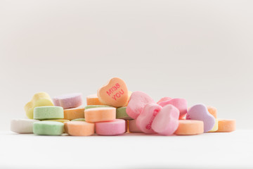 Valentine's day candy conversation hearts featuring the phrase Miss You