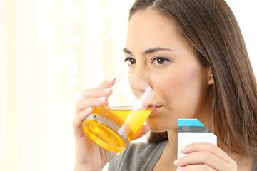 Woman drinking a medicine