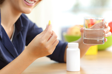 Woman hand holding omega vitamin 3 pill