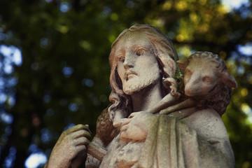 Ancient statue of Jesus Christ Good Shepherd