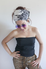 Portrait of a young woman wearing sunglasses and a bandana