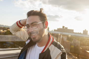 Portrait of a young man on a rooftop