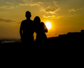 couple silhouetted by sunset