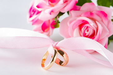 Wedding concept with rings and roses