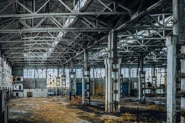 Abandoned large industrial hall with garbage. Voronezh excavator manufacturing factory