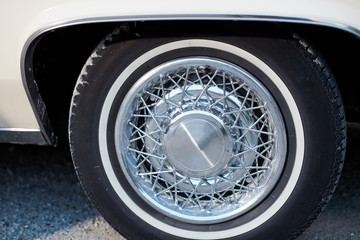 Close up of vintage chrome wheels with spokes