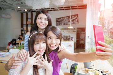happy woman friends in restaurant