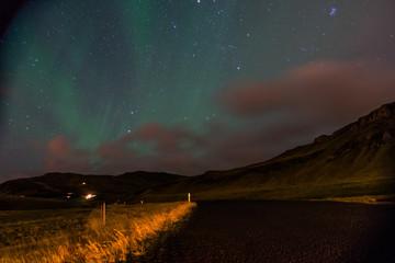 Northern lights Aurora Borealis above landscape in Iceland