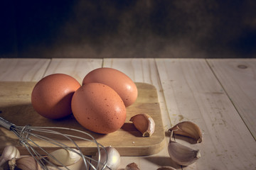 egg on wooden table, mystic photography and selective focus