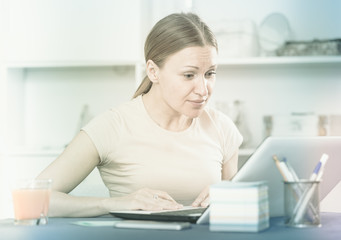 Frustrated woman with notebook