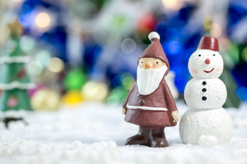 Santa claus and Snowman Standing Together on bokeh background. Christman Concept.
