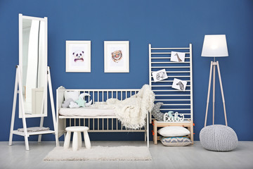Baby bedroom with pictures of animals on wall
