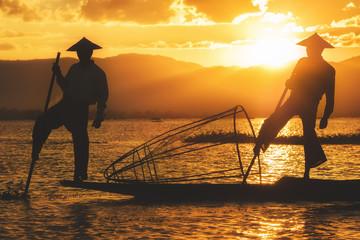 Inle Lake Intha fishermen at sunset in Myanmar, (Burma).