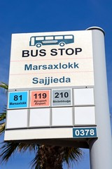 Bus stop sign showing destinations and bus numbers, Marsaxlokk, Malta.