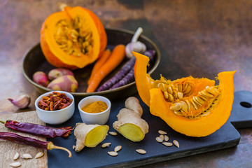 Ingredients for delicious and spicy Thai pumpkin cream soup.