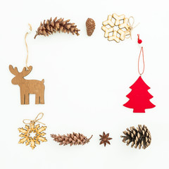 Christmas frame of tree, snowflakes, snowman and pine cones on white. Flat lay, top view. New Year frame concept