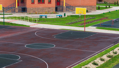 Foto op Plexiglas Stadion Schoolyard with a playground for basketball. Doing sports at school
