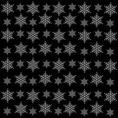 White snowflakes on a black background.Christmas background.