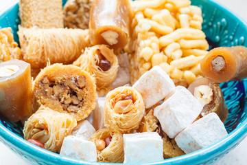 Classic honey oriental sweets in a blue bowl