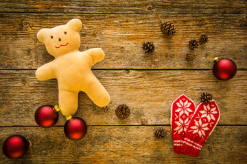 Christmas background. Ornaments, teddy bear and gloves